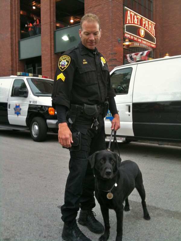 Policeman with Labrador Retriever