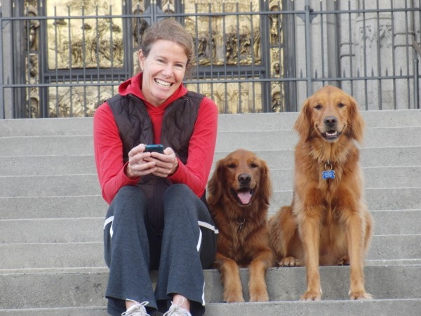 Woman and Two Golden Retrievers
