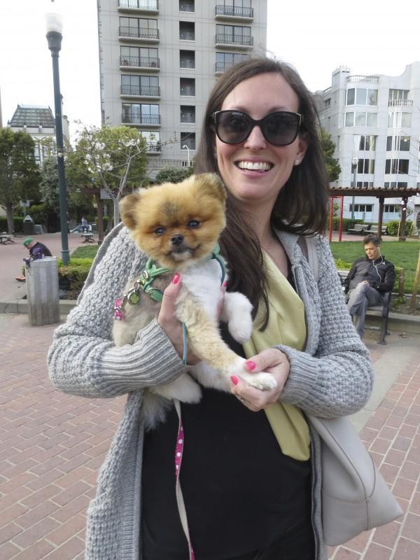 Woman Holding a Pomeranian
