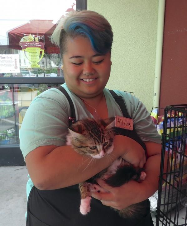 Woman Cuddling Tiger Tabby Kitten
