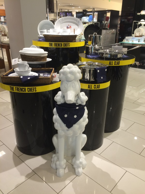 Huge White Ceramic Poodle In Front Of Cookware Display