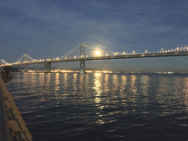 Picture Of The Moon Seen Through The Bay Bridge At Night