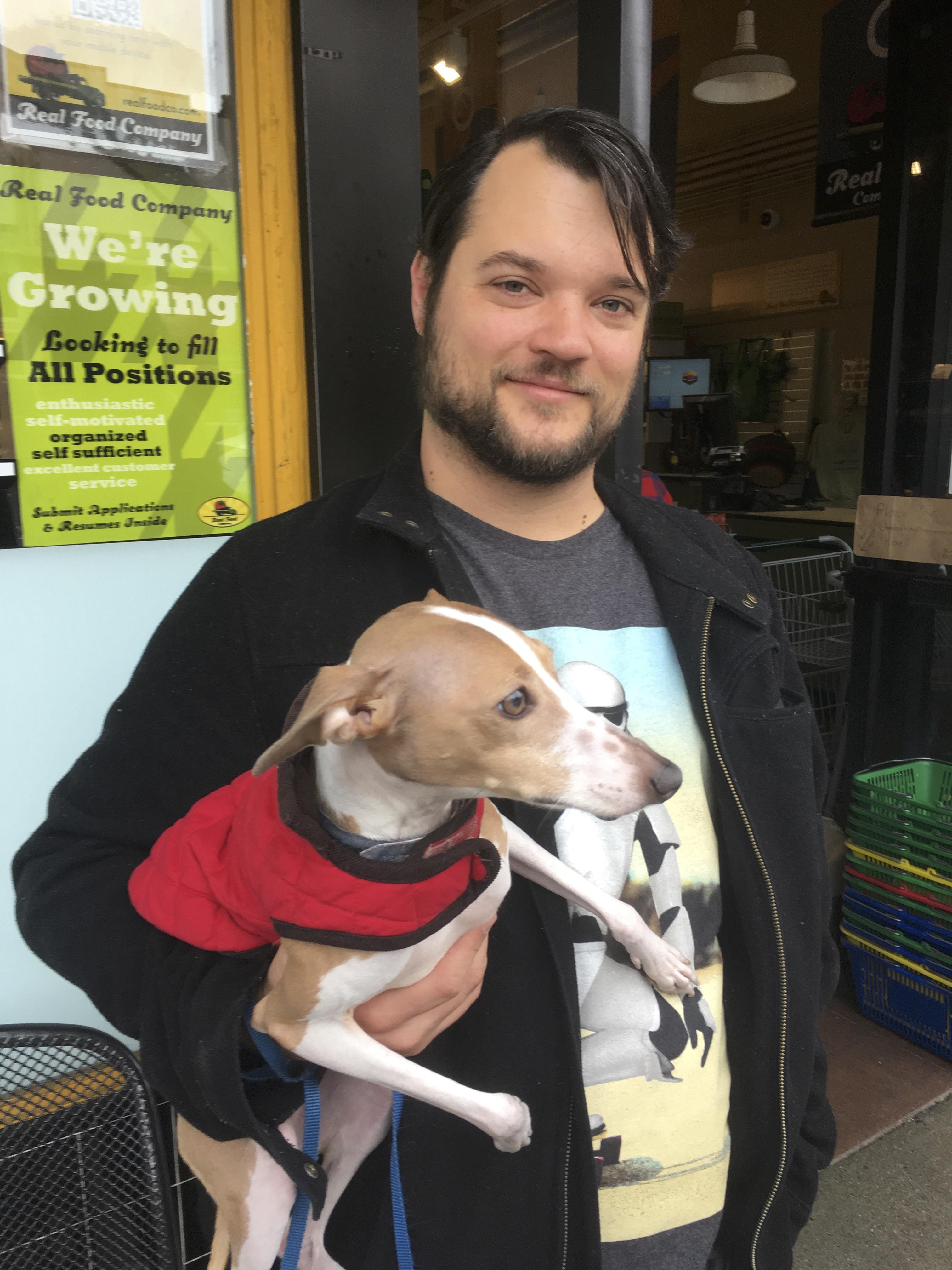 Man Holding Italian Greyhound
