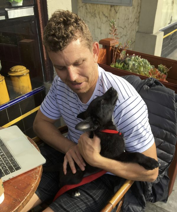 4 Week Old Black Border Collie Labrador Retriever Mix Hugging Man