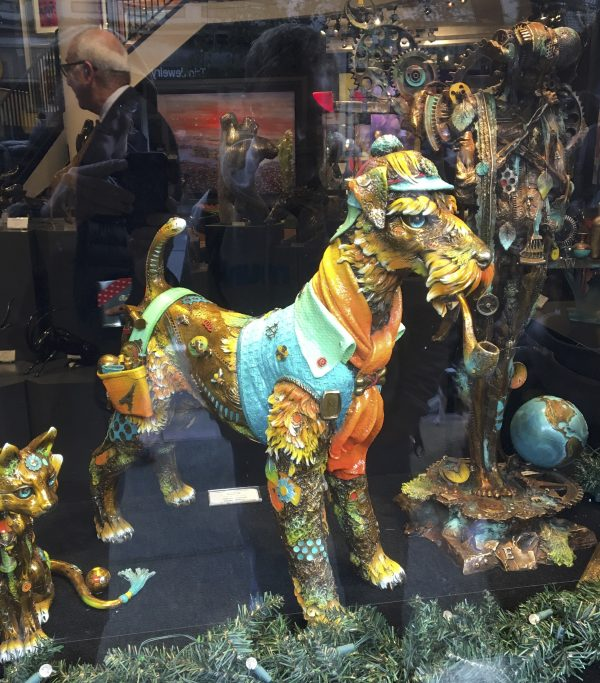 Pretty Clockwork-Looking Dog In Window Of Shop