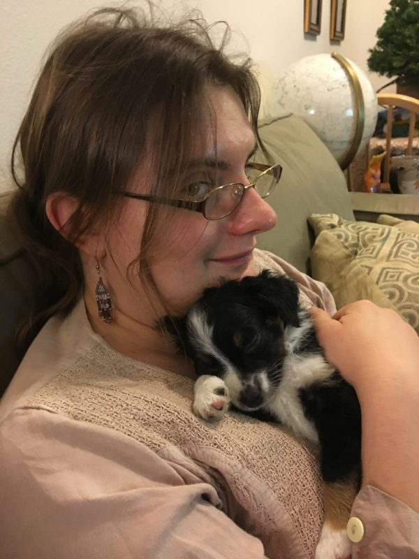 Ridiculously Adorable Australian Shepherd Puppy Sleeping In Woman's Arms