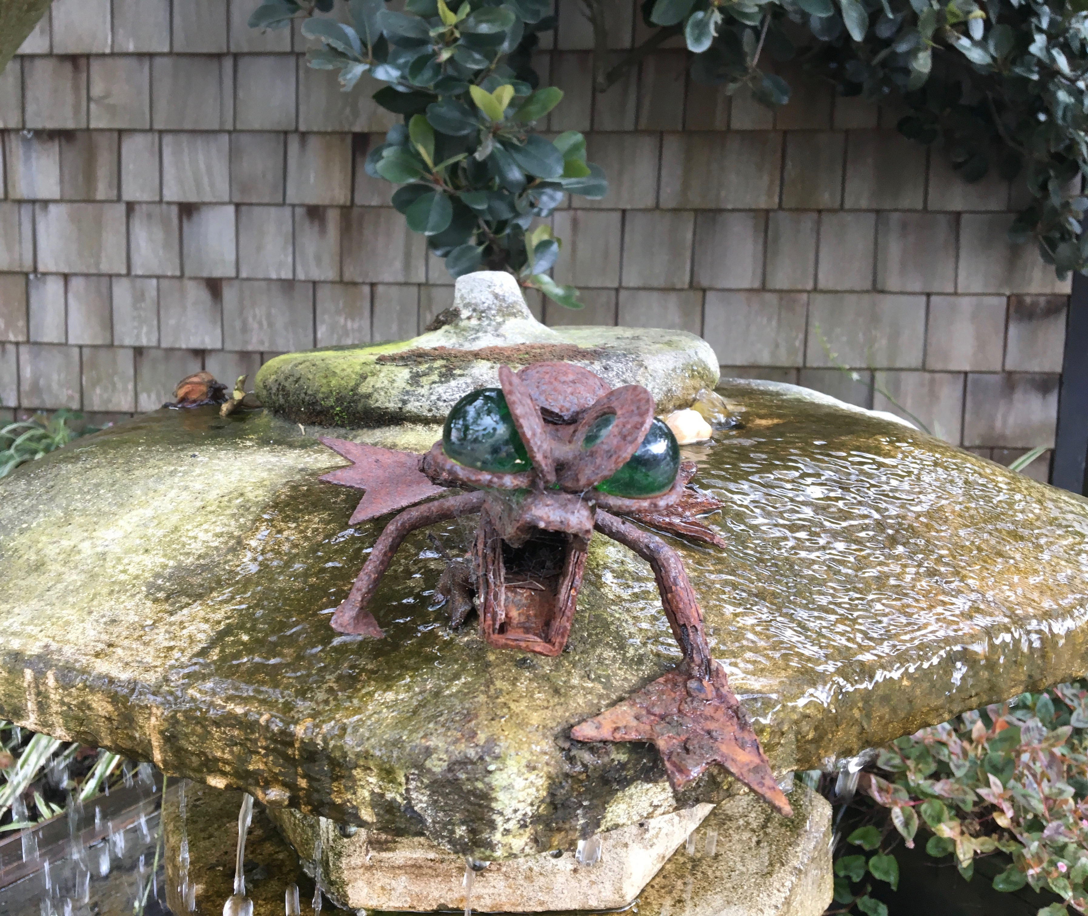 Rusty Statue Of A Frog In A Fountain
