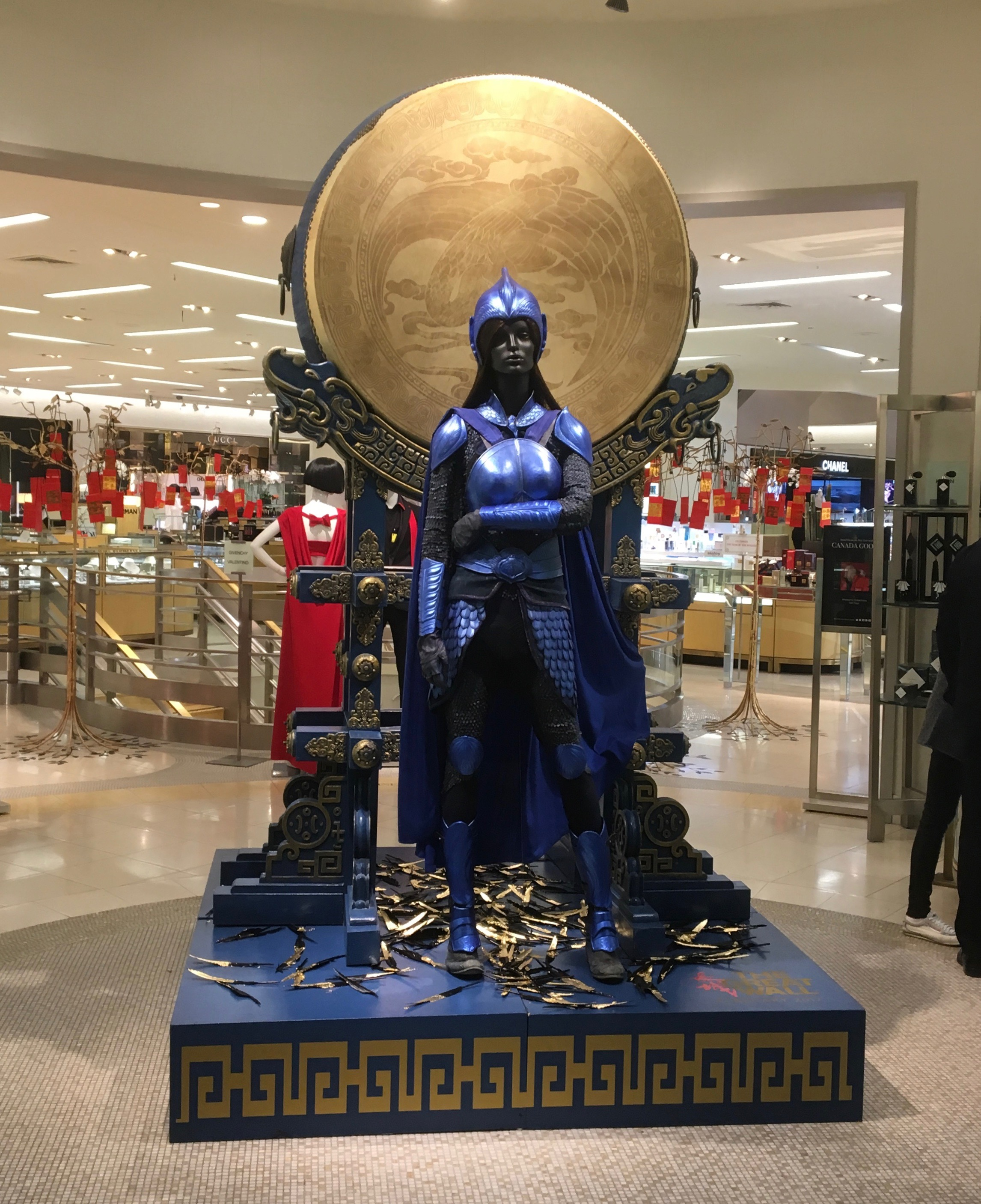 Statue Of Woman In Blue Armor