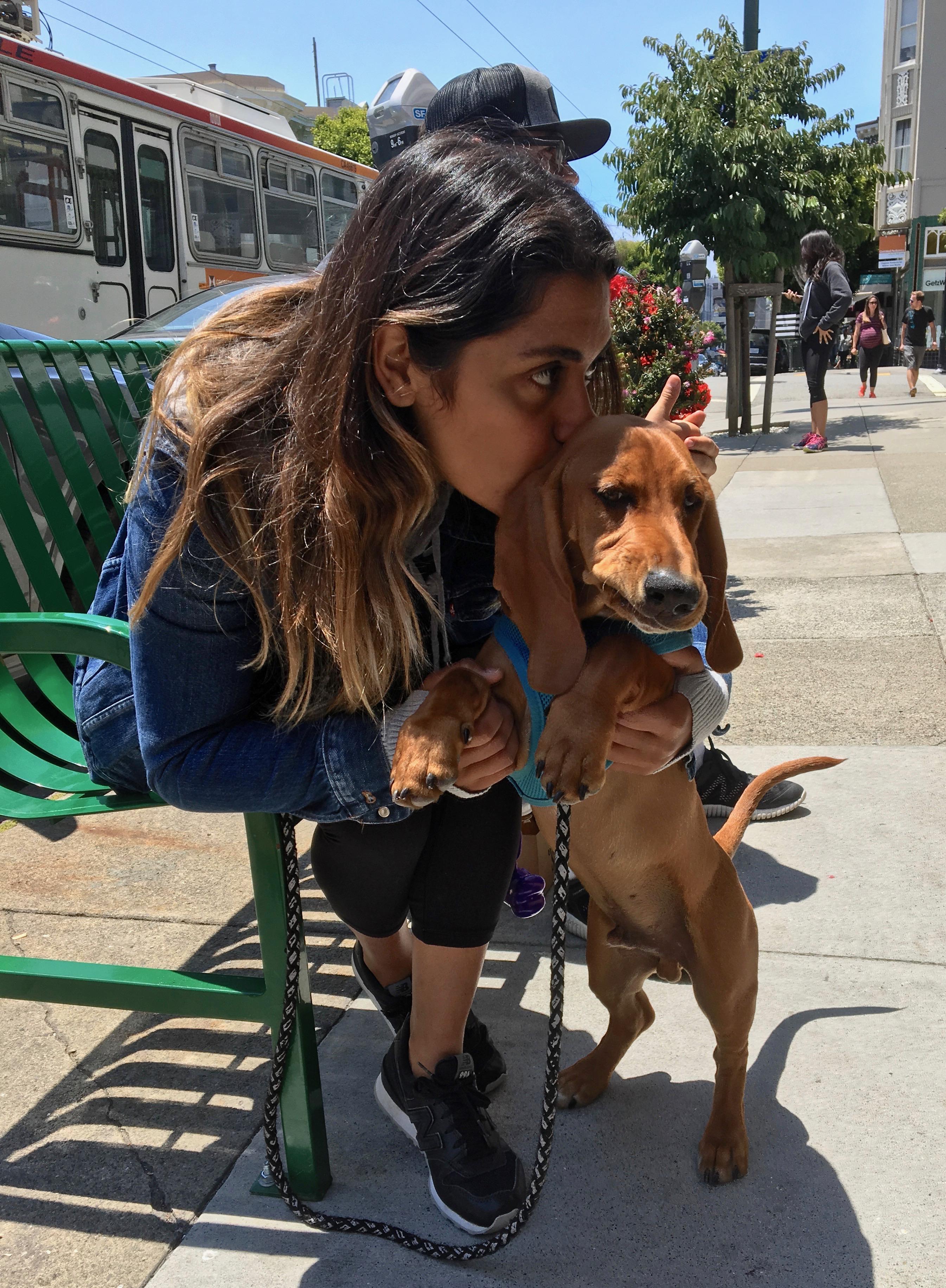 Woman Smooching Dachshund Bassett Hound Mix Puppy