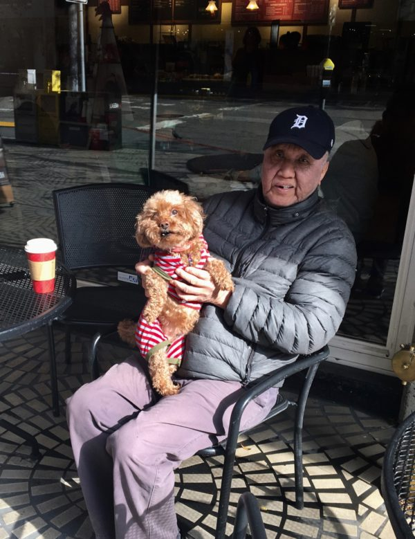 Man With Snarling Apricot Poodle