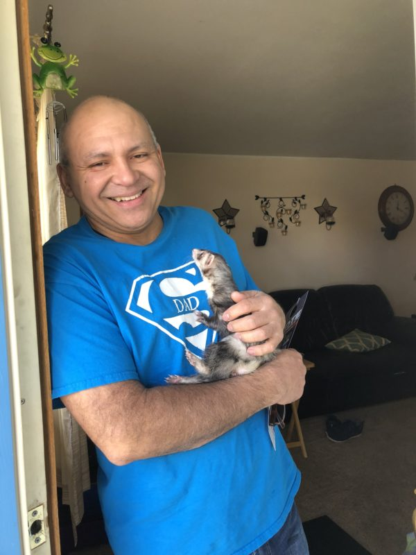 Man In Superdad Shirt Holding Ferret
