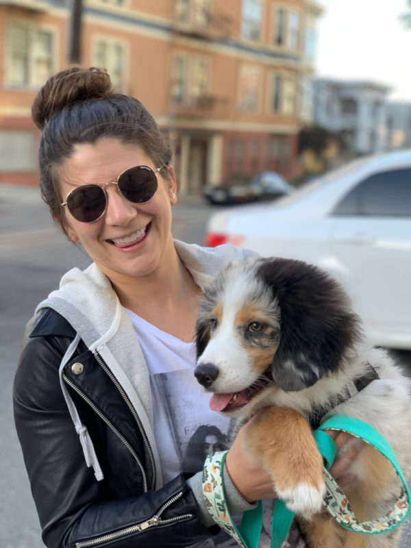 Woman Holding Adorable Fluffy Australian Shepherd Puppy