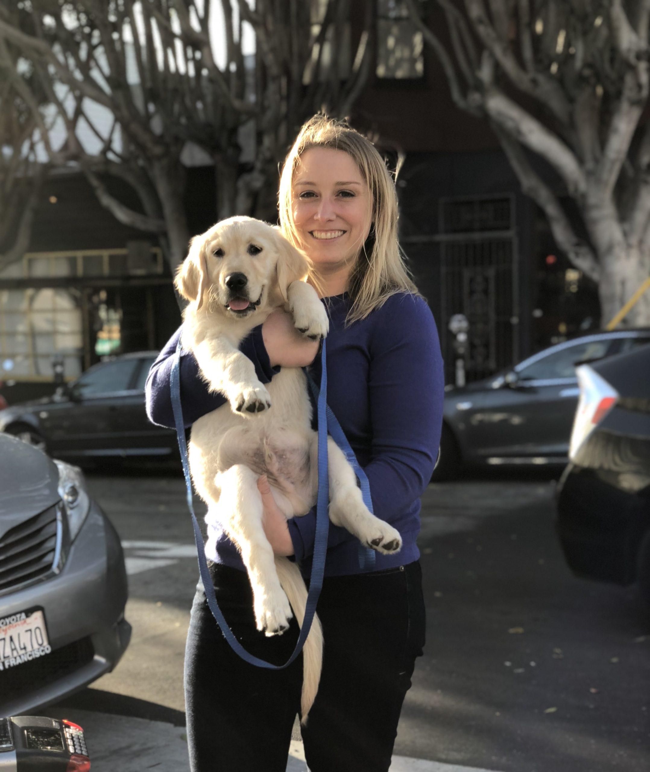 Woman Holding Golden Retriever Puppy