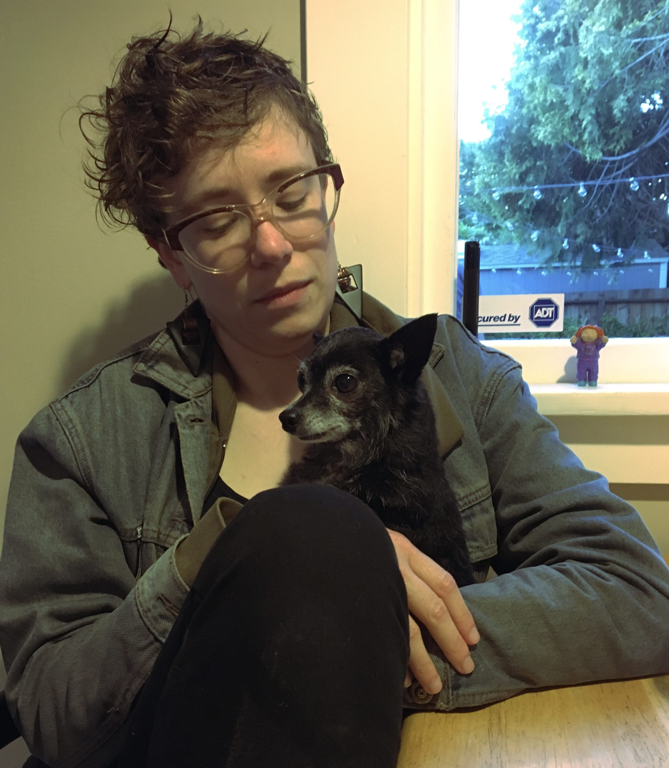 Woman Holding Noble-Looking Chihuahua